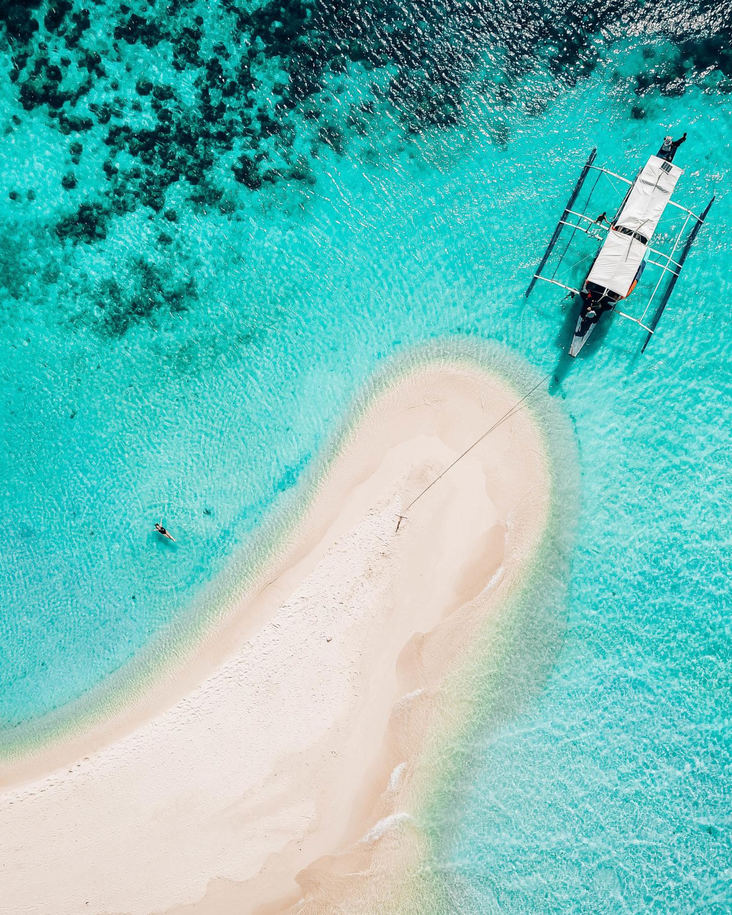 aerial photo of Ditaytayan Island Sandbar with woman in water