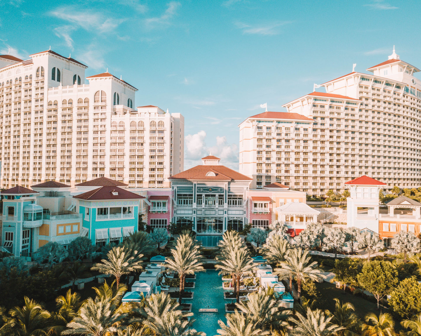 drone shot of grand hyatt baha mar with colorful buildings blue sky and palm trees