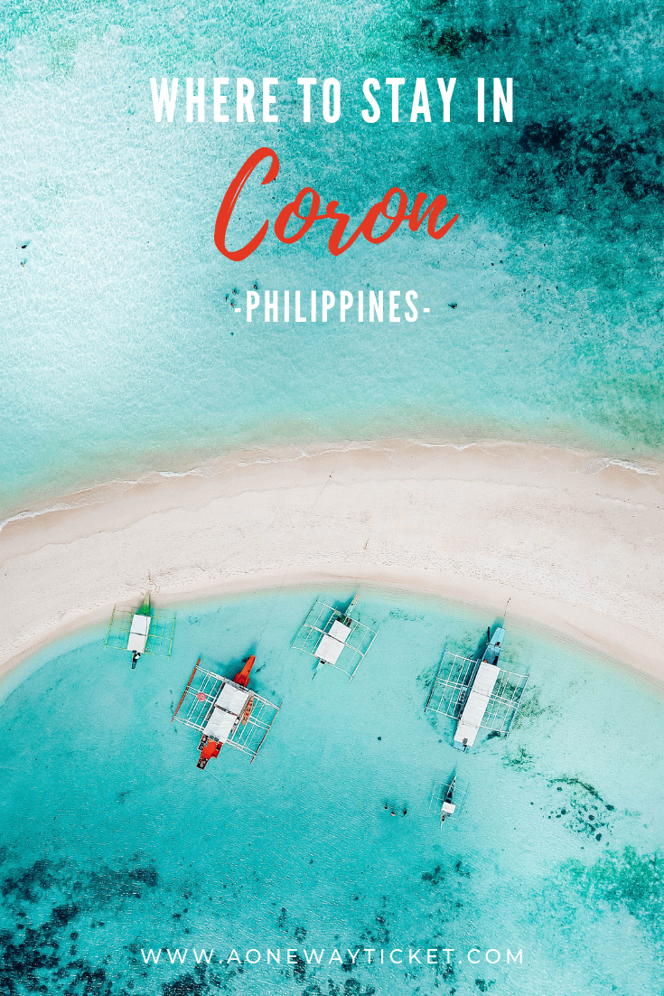 Drone photograph of white sand island against bright blue tropical water in the Philippines