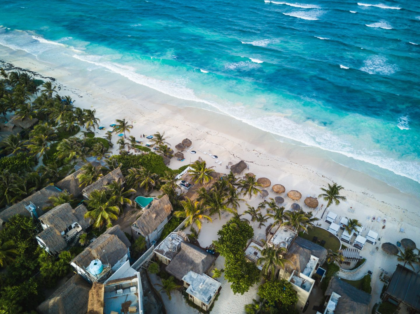 Learn all about the best adults only all-inclusive resorts in Mexico. You'll get to stay on beautiful, white sand beaches, just like this one!