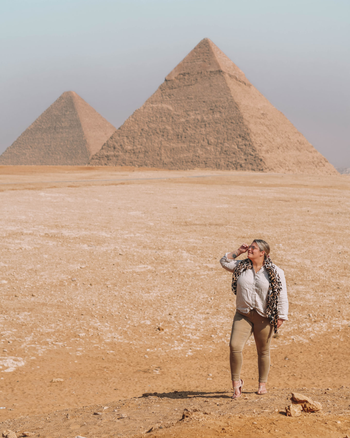 standing in front of great pyramids of giza | egypt itinerary