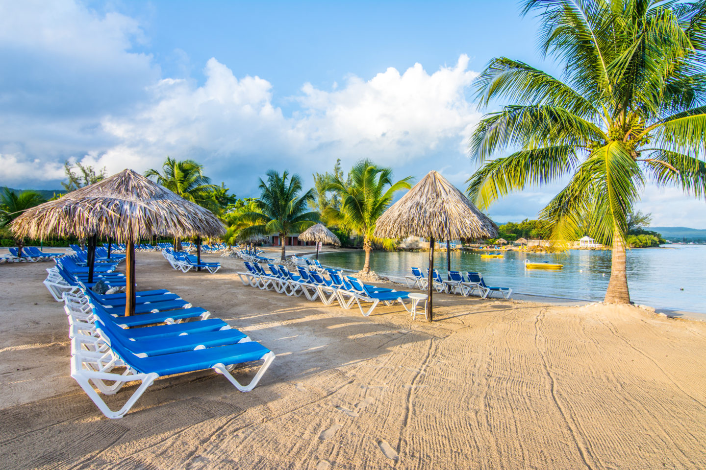 Beach with palm trees at Jewel Paradise Cove in Jamaica