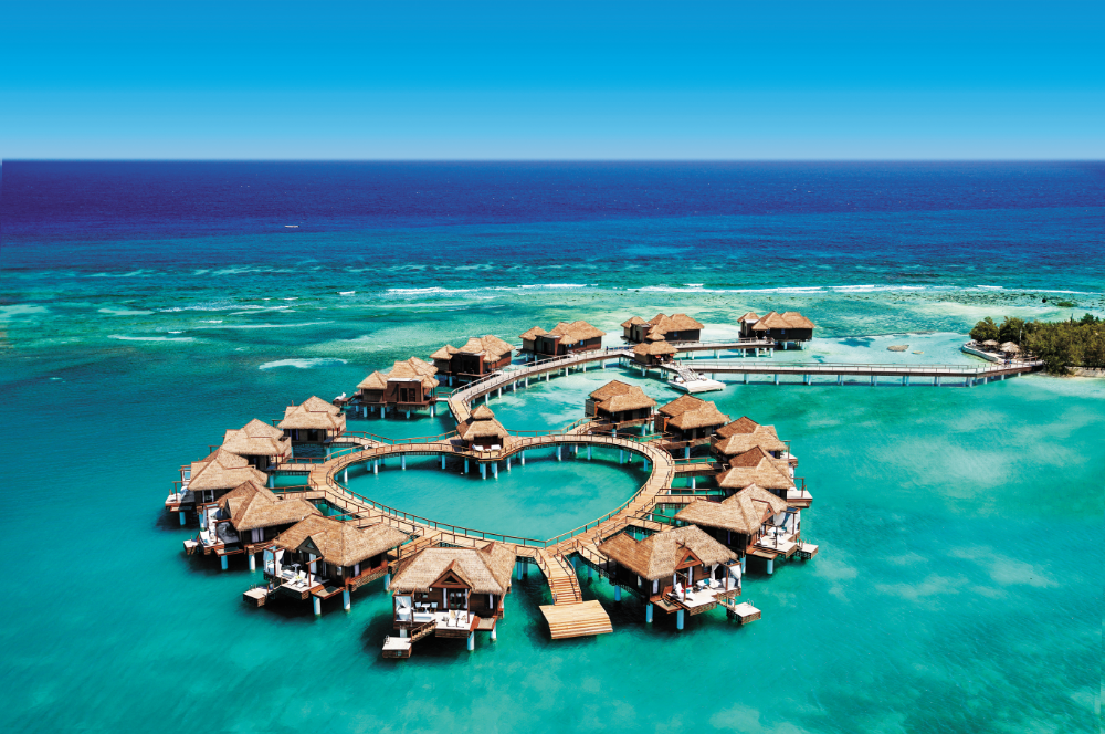 heart shaped layout aerial photograph of overwater villas at sandals royal caribbean