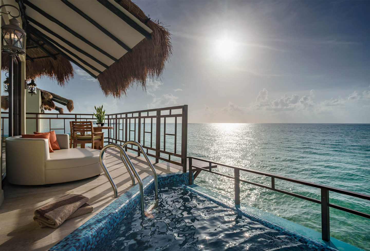 looking out from overwater bungalows in the caribbean palafitos el dorado maroma