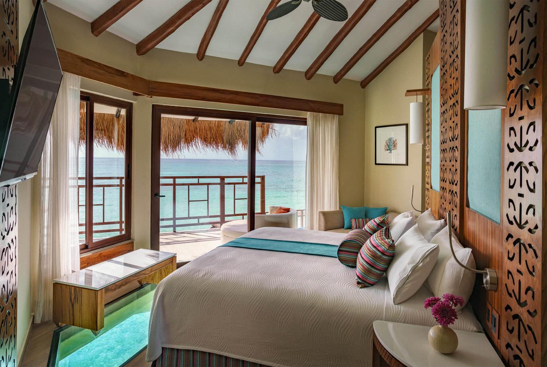 interior view of overwater bungalows in the caribbean palafitos el dorado maroma
