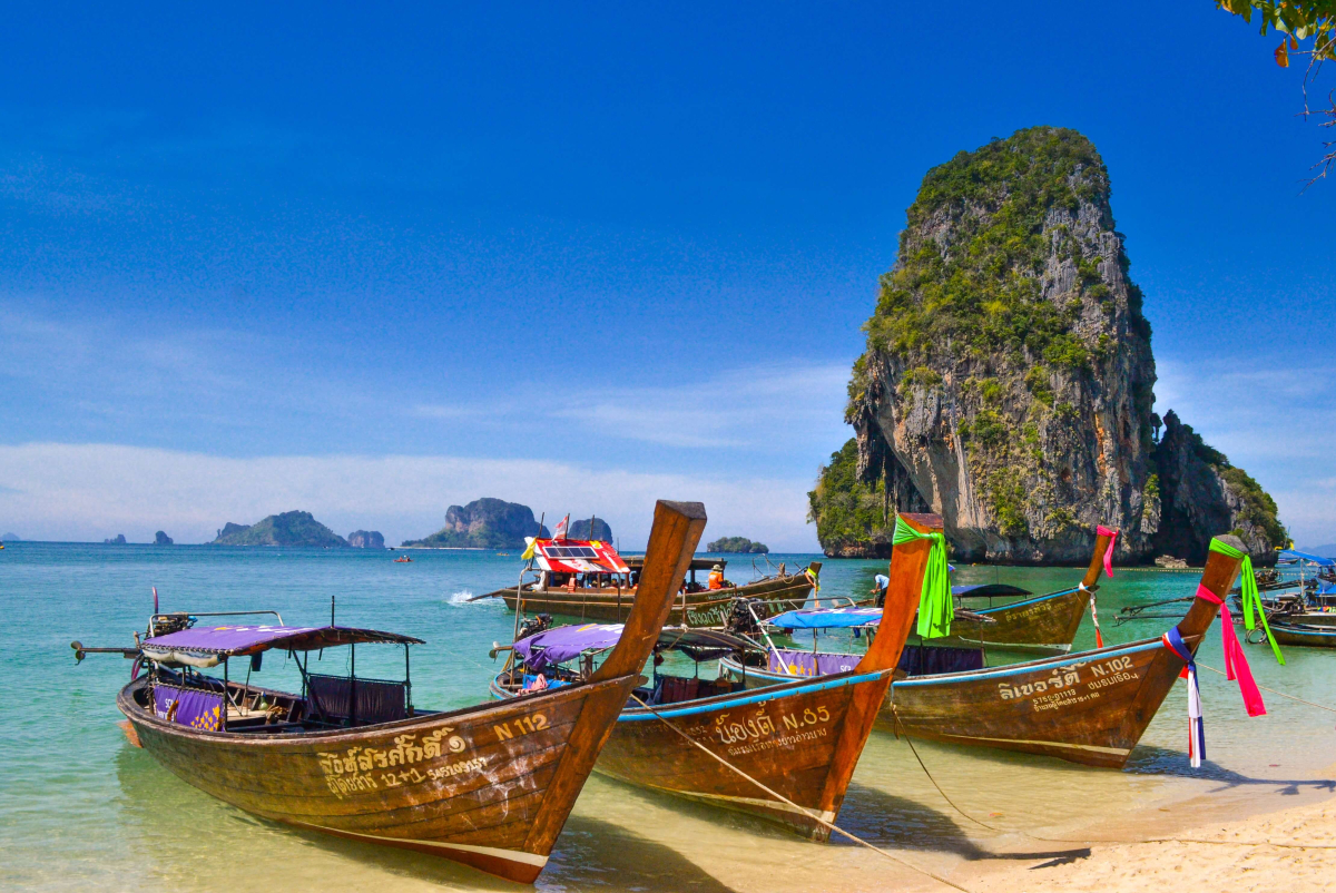 10 day thailand itinerary - traditional thai boats on beach