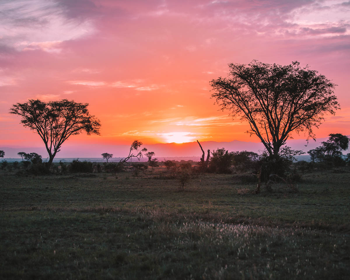 sunset in queen elizabeth national park uganda itinerary