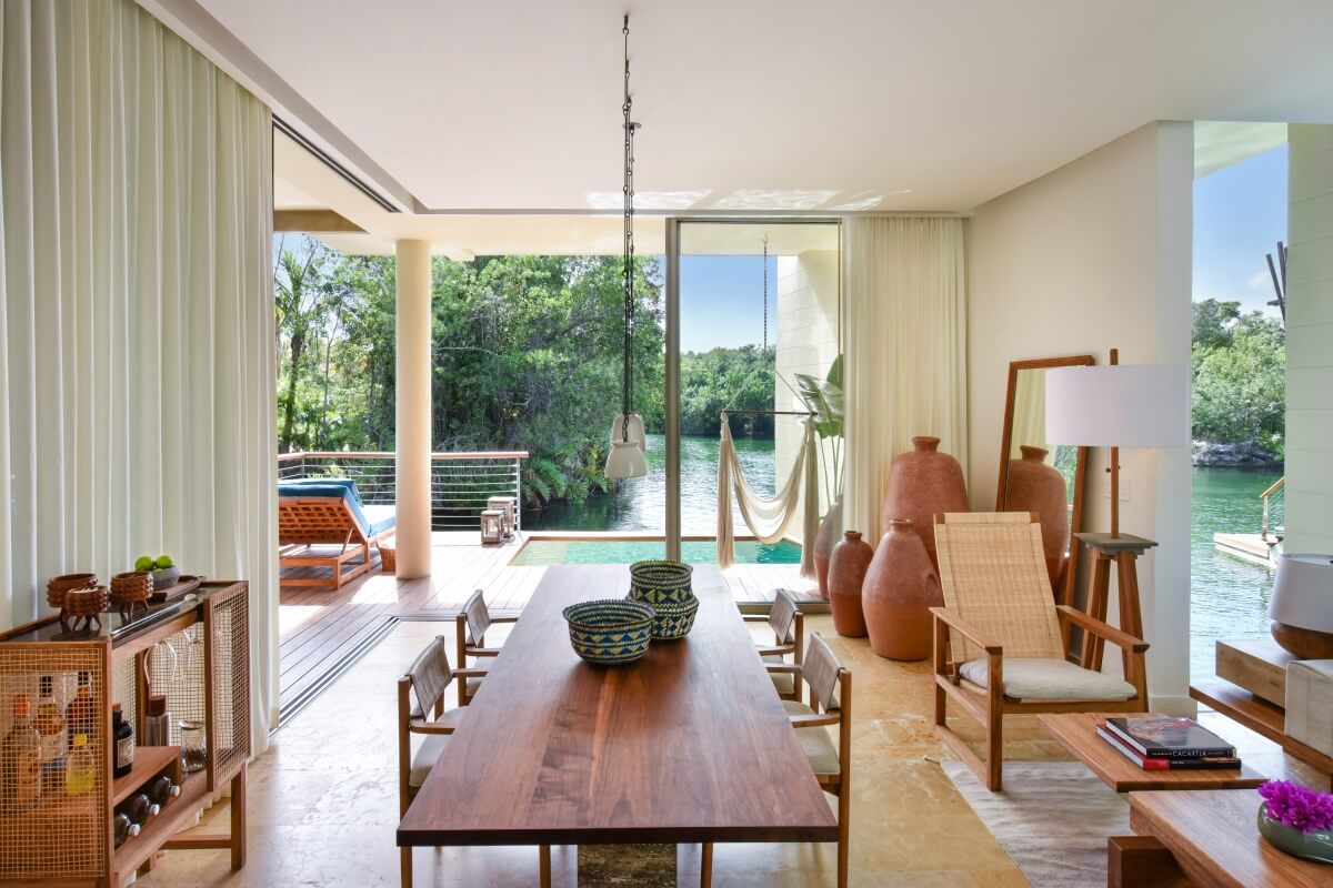 overwater bungalows in mexico rosewood mayakoba dining room area