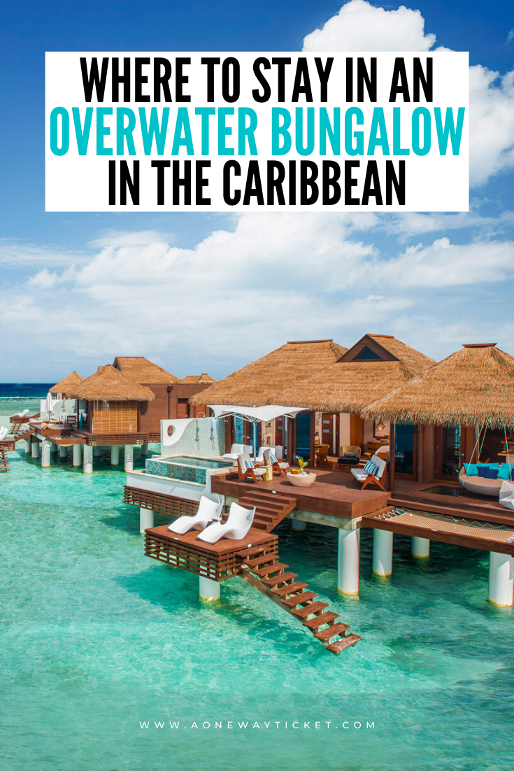 overwater bungalow in the caribbean over bright blue water with blue skies