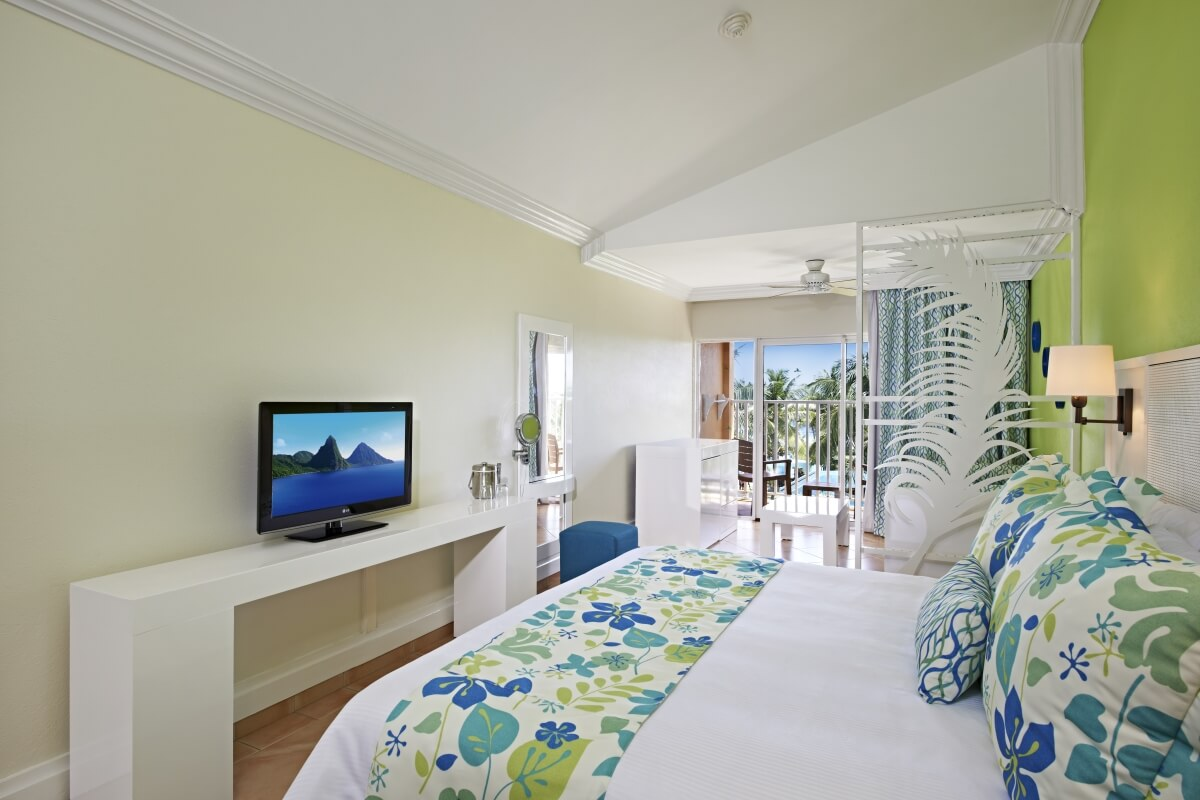 inside a colorful guest room at coconut bay beach resort