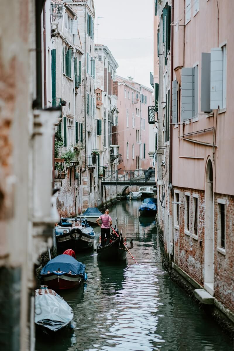 gondola in the distance in the canal in venice italy