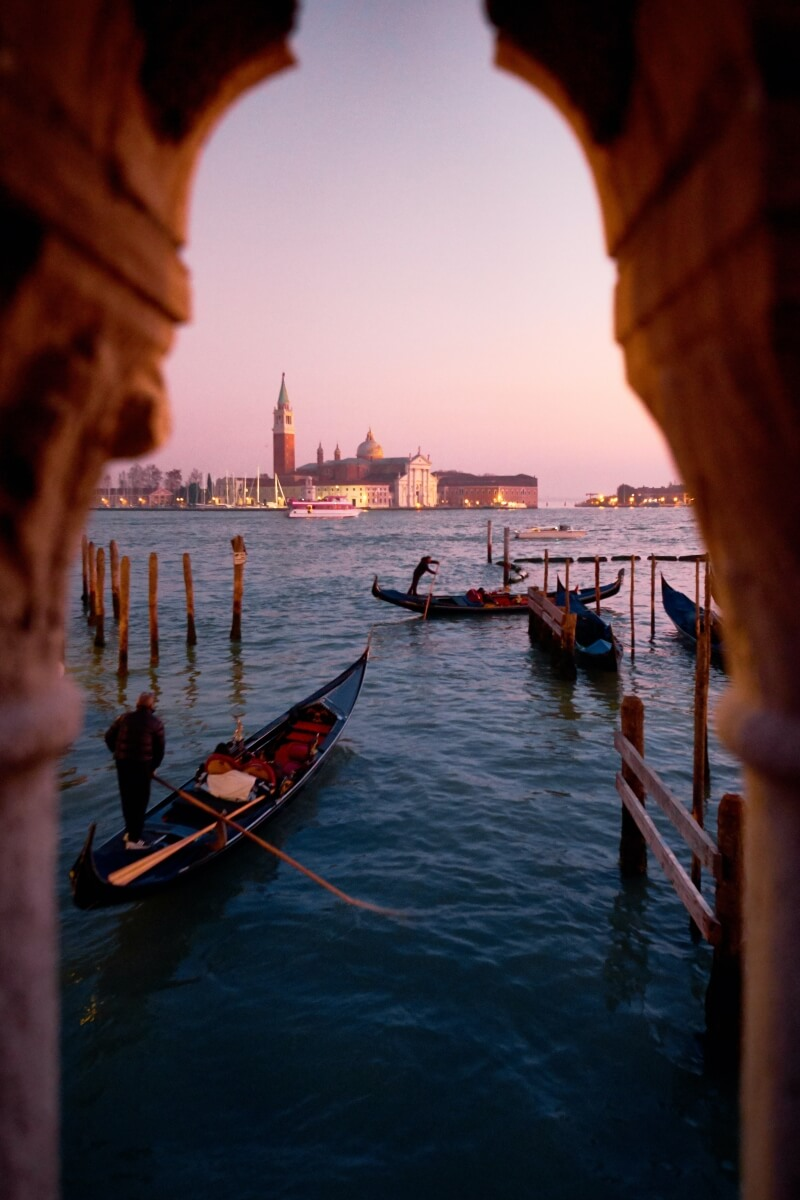 view of the water in venice with gondolas italy itinerary
