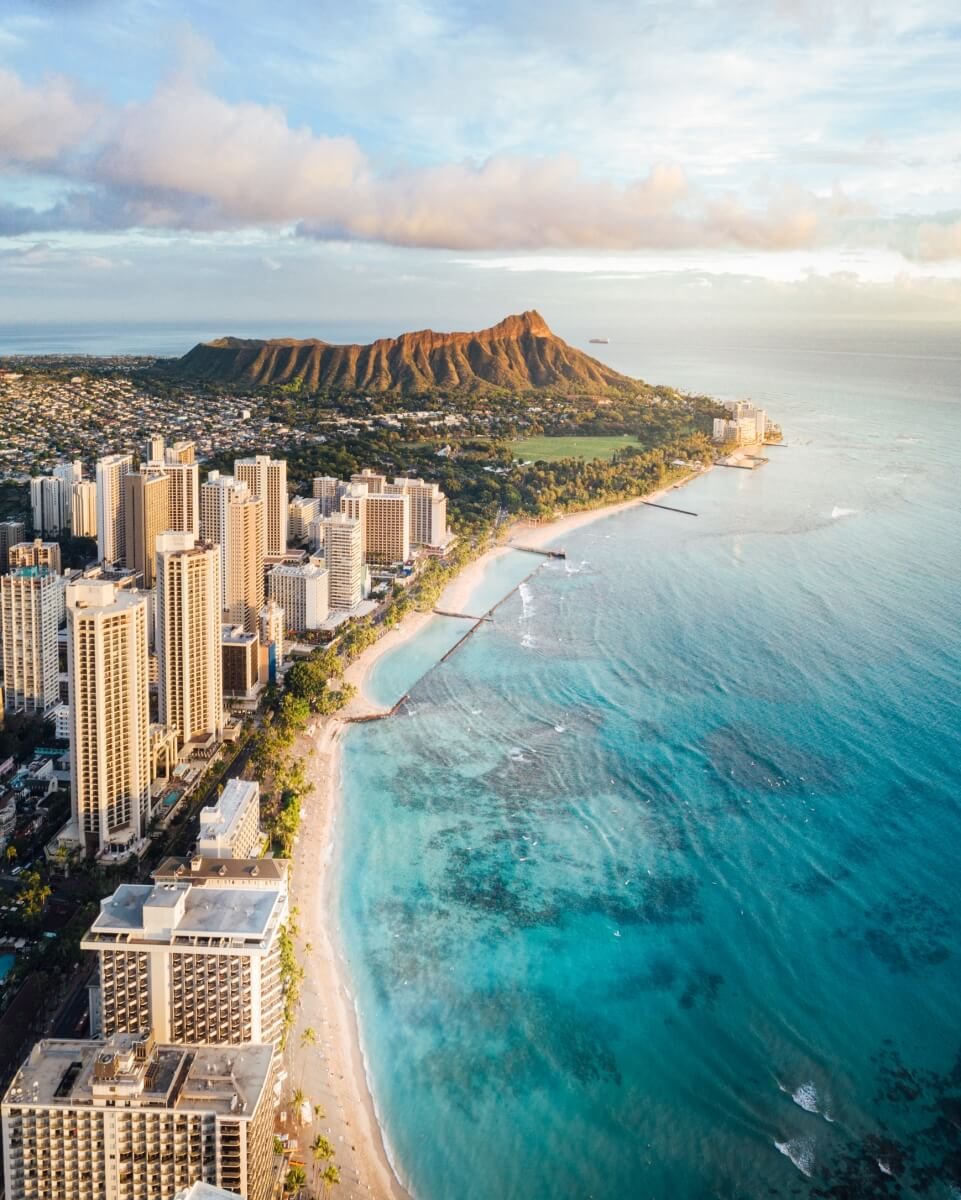 view of waikiki from the sky with diamond head in the back day trip from maui to oahu