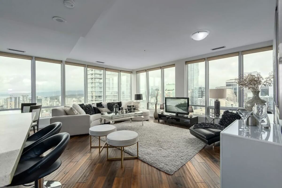 bright and open concept airbnbs in vancouver with floor to ceiling windows and views of the city