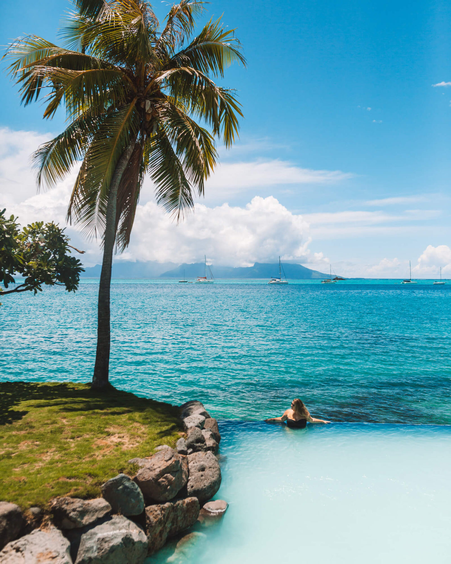 view of moorea in the background at the sandy bottom pool at intercontinental tahiti