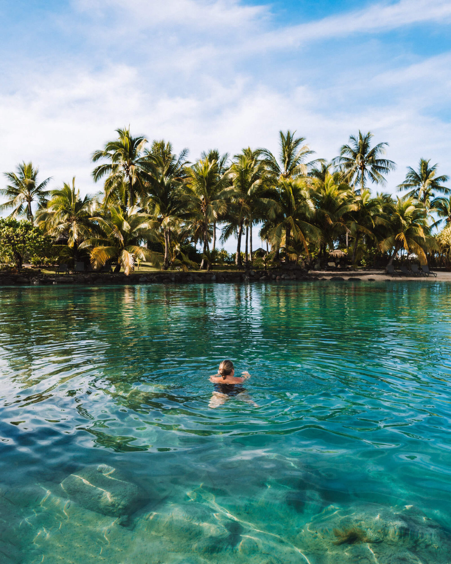 woman swimming in the lagoonarium at the intercontinental tahiti