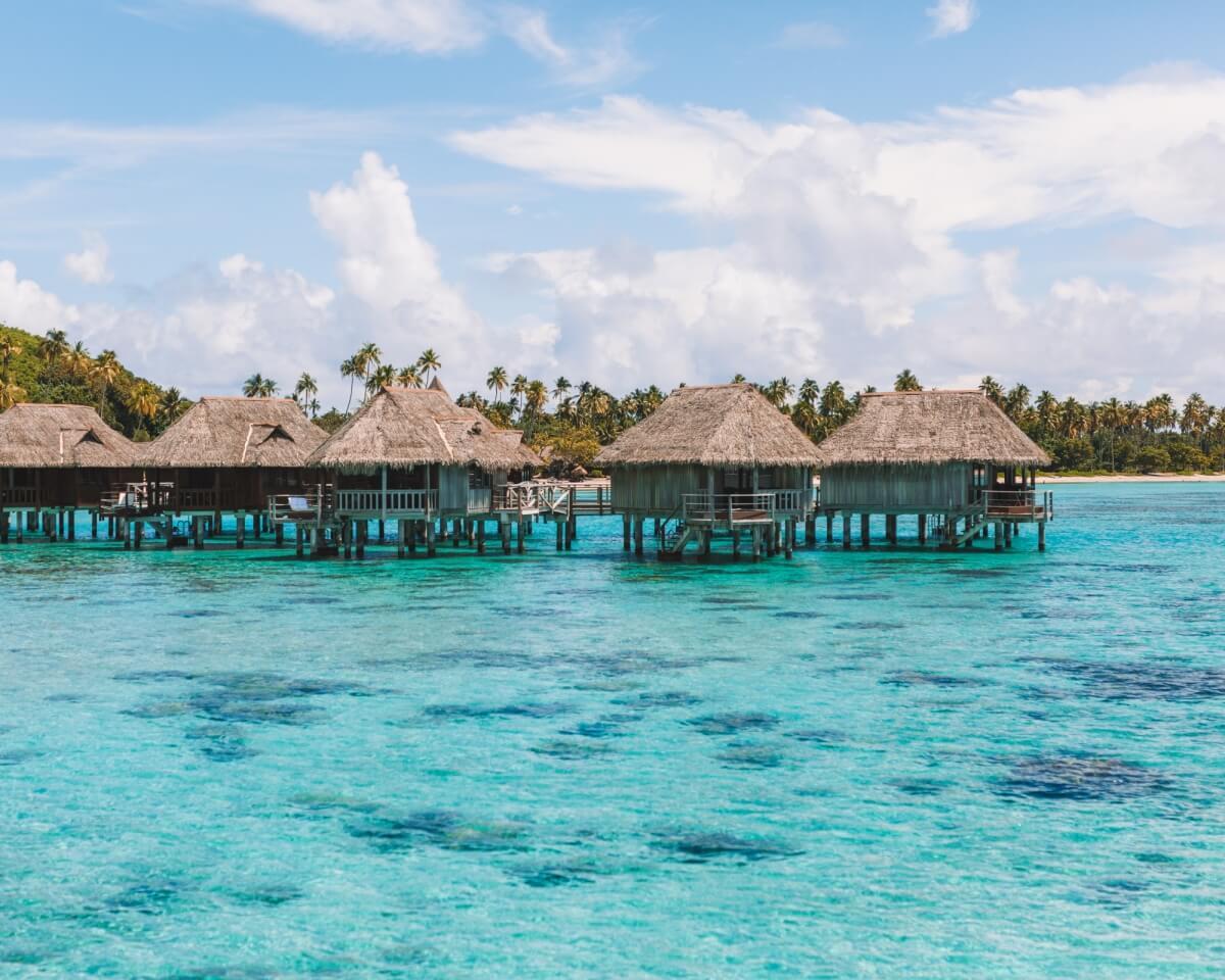 photo of a row of overwater bungalows at the sofitel kia ora beach resort moorea vs bora bora