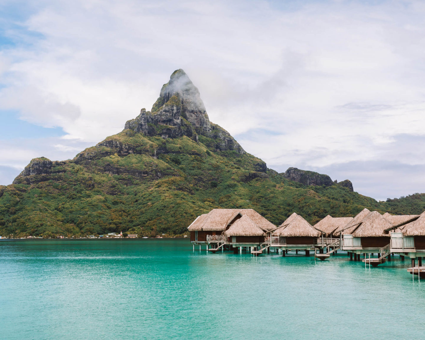 intercontinental thalasso resort's view of mount otemanu with overwater bungalows lining the bottom of the mountain on the right side