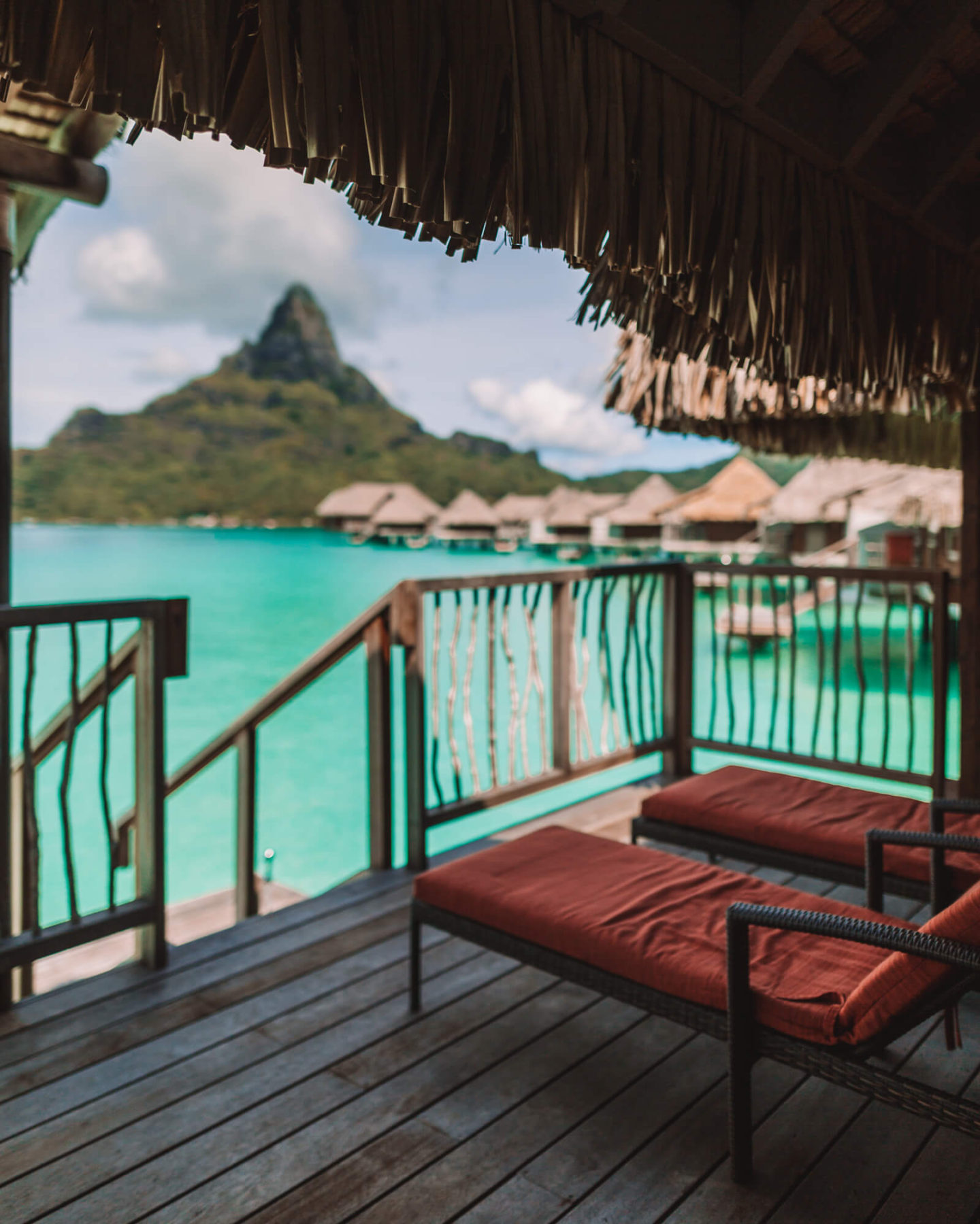 view of mount otemanu in bora bora from inside an overwater bungalow at intercontinental thalasso resort