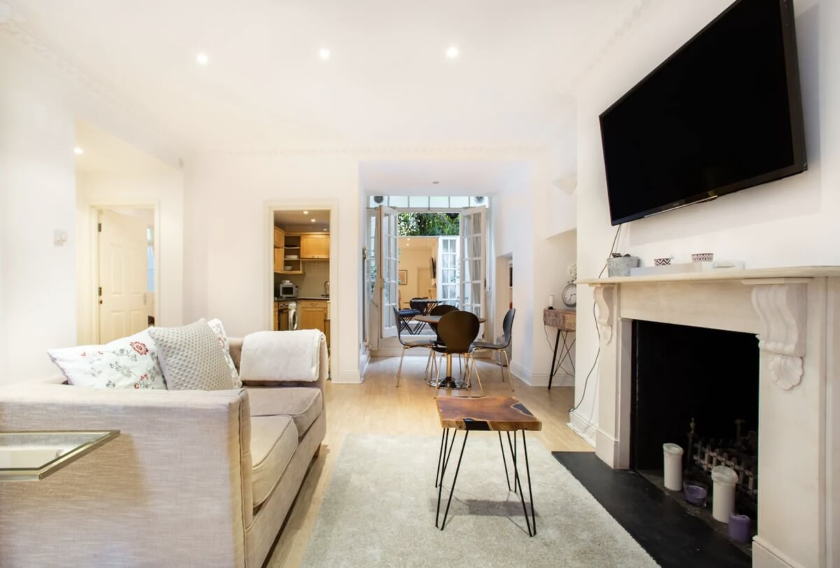bright airbnbs in london with a fireplace and simple decor