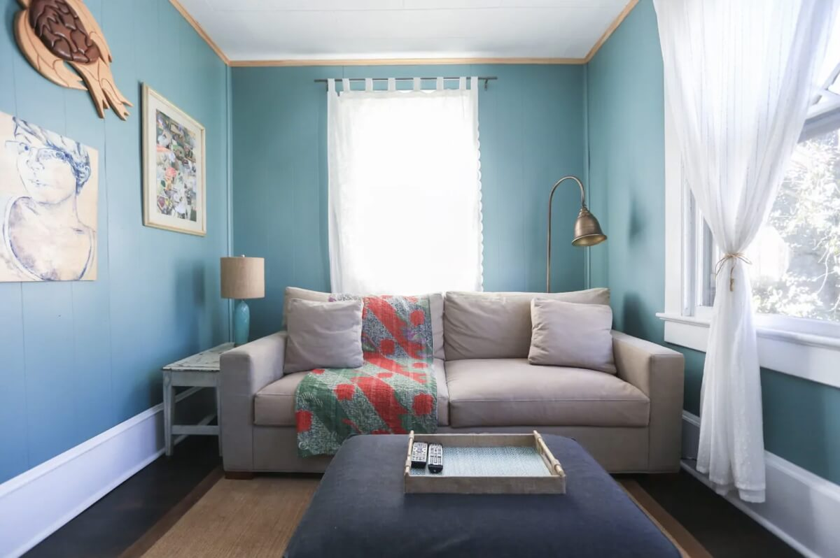 homey apartment with tan couch and accent pieces airbnbs in asheville